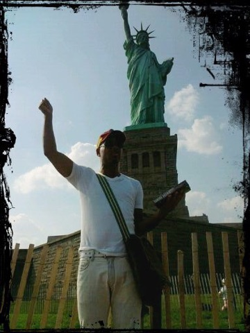 The author salutes the Statue of Liberty