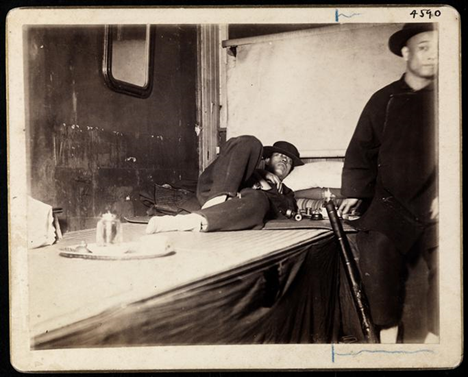 A man lying next to an opium joint